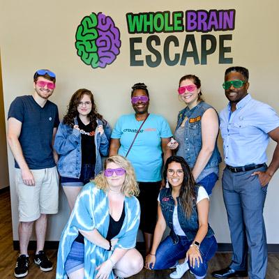 Team building event participants at Whole Brain Escape in Apex.