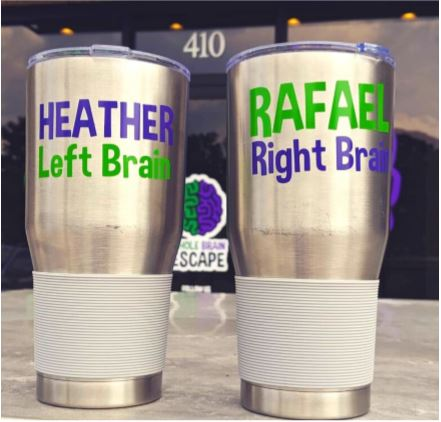 Matching stainless steel mugs one says Heather is left brain and the other Rafael is right brained.
