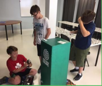 Young boys getting ready to enter the Escape Room Raleigh