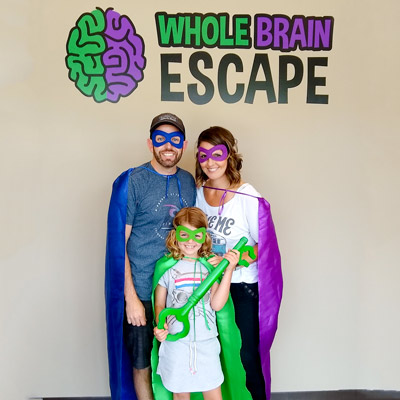 Mom, Dad and child out for Sunday Escape Room Fun at Whole Brain Escape.